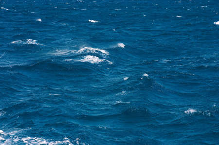 Waves with white horses on a surface of the sea Stock Photo