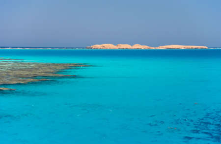 The red sea a coral reef, island on horizon Stock Photo