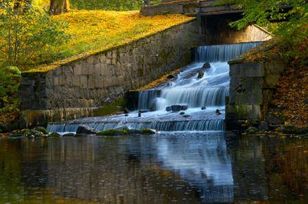 Dam and falls under the stone bridge photo