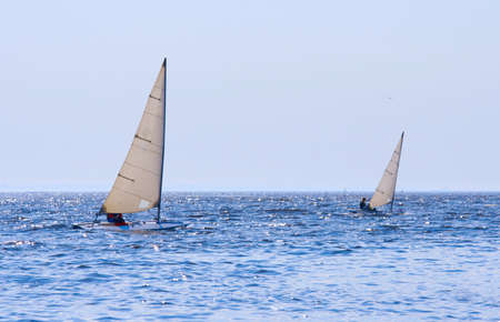 Regatta of sailing boats on the sea in solar windy day