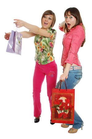 Two funny girls carrying bags. isolated on white Stock Photo - 3209445