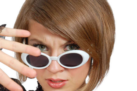 discontent: Discontent young woman in sunglasses isolated on white