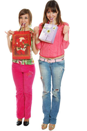 Two fresh pretty girls carrying bags. isolated on white Stock Photo - 3329894