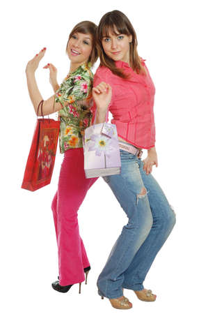 Two fresh pretty girls go shopping. isolated on white Stock Photo - 3329860