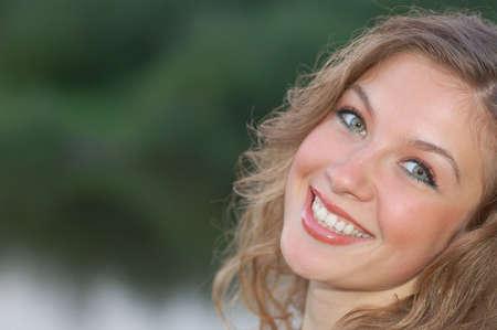 attractive smiling girl looking at camera
