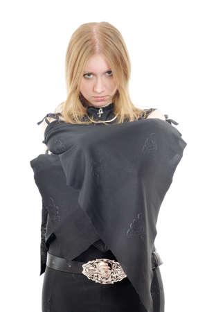 Posing gothic girl with bat-like sleeves, isolated on white photo