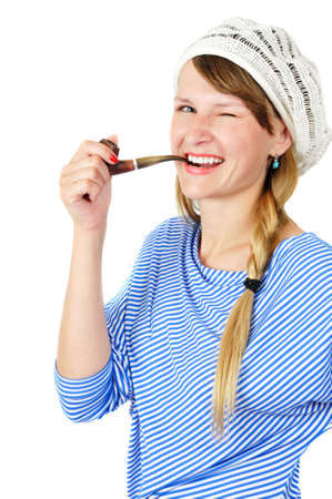 winking girl with a pipe, isolated on white photo