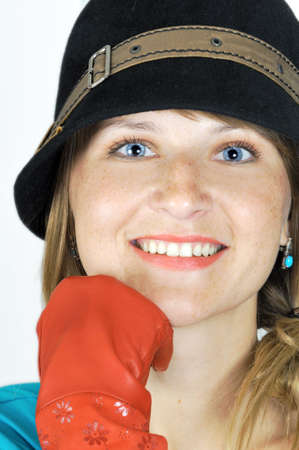 vouge: pretty blue-eyed girl in hat and red gloves