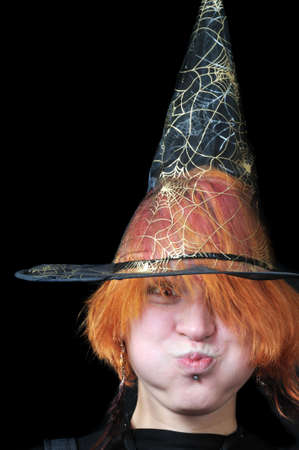 redhair scarecrow in wizard's hat on black background Stock Photo - 3714588
