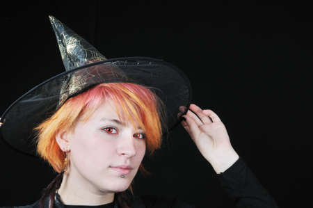 portrait of nice witch with hat on black background Stock Photo - 3759962