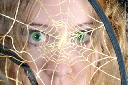 wep: Scared look through spiders web Stock Photo
