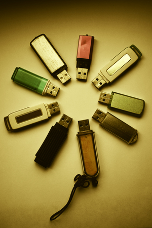 many flash drives spread out in a circle in the form of a flower