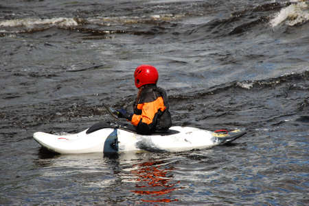 pratice: Kayaker in a with boat