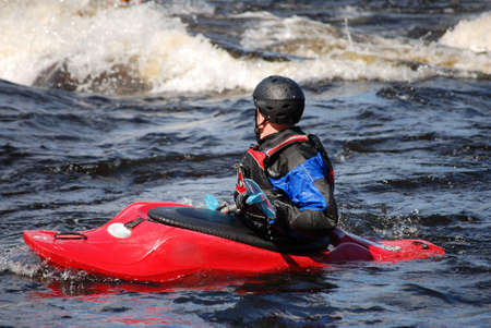 kayaker: Kayaker in a red boat