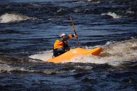 pratice: Kayaker in a yellow boat  Stock Photo
