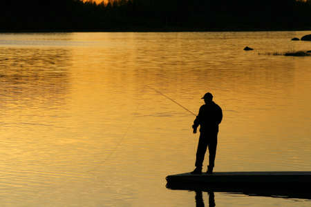 Fishing at the sunset photo