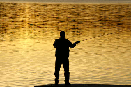 Fishing at sunset Stock Photo - 3250087