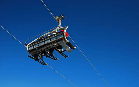 Chairlift transporting skiers photo