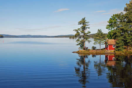 Calm lake and a red house