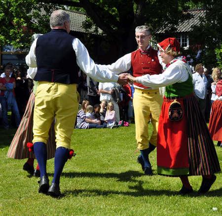 midsummer: Torstuna, Sweden, June, 19, 2009 : Folklore ensemble in traditional folk costyme at Midsummer day.