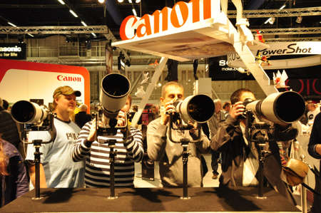 Stockholm, Sweden - November 19: People visit stand looking for cameras and lenses during photoshow, international photo and digital imagine exhibition on November 19, 2011 in Stockholm, Sweden