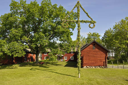 midsummer pole: House and midsummer tree Stock Photo
