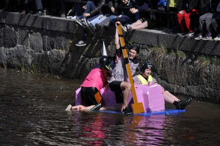 Uppsala, Sweden - 30 April: A participant in a funny boat race in action at Uppsala, Sweden April 30, 2012 Stock Photo - 13576193