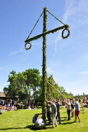 Torsstuna, Sweden-June 22: Folklore ensemble of Sweden in traditional folk costyme perform a dance in midsummer day on June 22, 2012 in torstuna, Sweden.