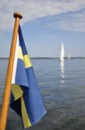 Detail of a sailboat along the coast, swedish flag photo