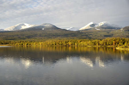 Calm lake reflection, abisko national park in Sweden Stock Photo - 15237571