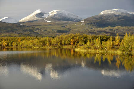 Calm lake reflection, abisko national park in Sweden Stock Photo - 15237570