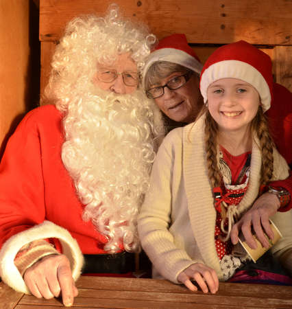 Gysinge, Sweden - December 08: Portrait of Santa claus with Santa girl at Christmas time in Gysinge on December 08, 2012 in Gysinge Sweden. Stock Photo - 16769553