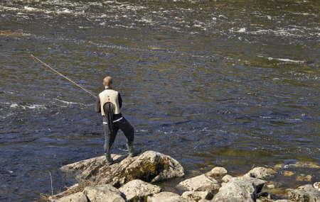 Fisherman in Swedish natural salmon area Stock Photo - 17107875