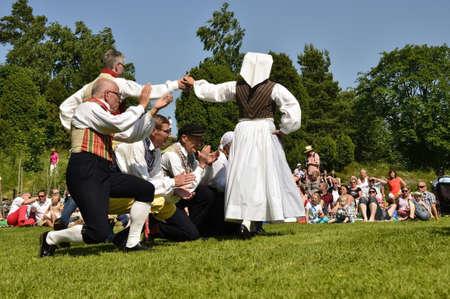 Torstuna, Sweden - June 21: Folklore ensemble of Sweden in midsummer event on June 21, 2013 in Torstuna Sweden