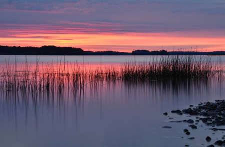 Calm lake in midnight light photo