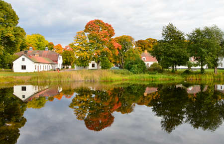 Riverside cottage in autumn photo