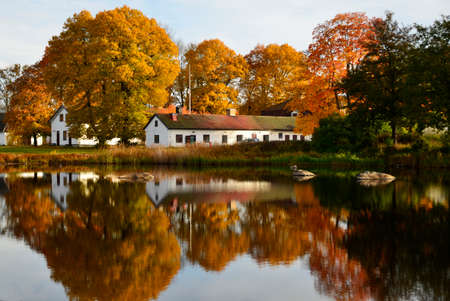 Cottage stand by the Riverside landscape in autumn photo