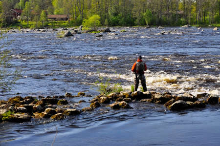 Fishing in the salmon river at spring photo