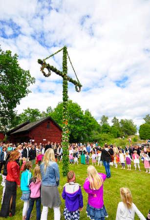 Torstuna, Sweden - June 20  People dance around the Maypole at midsummer day on June 20, 2014