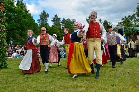 Torstuna, Sweden - June 20   Folklore ensemble of Sweden in traditional folk costume at midsummer day 20 June 2014