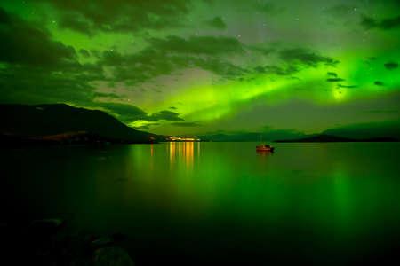 Northern lights over calm lake in Abisko Aurora borealis