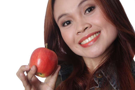 Woman holding an apple Stock Photo - 3923695