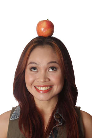 Woman with apple on her head Stock Photo - 3923679