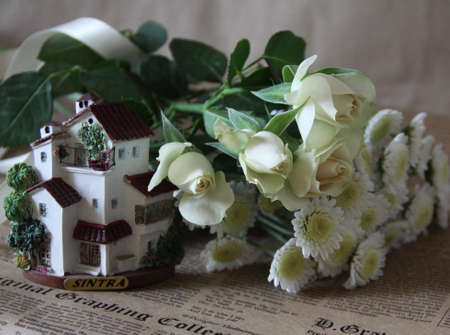 House and white flowers Stock Photo