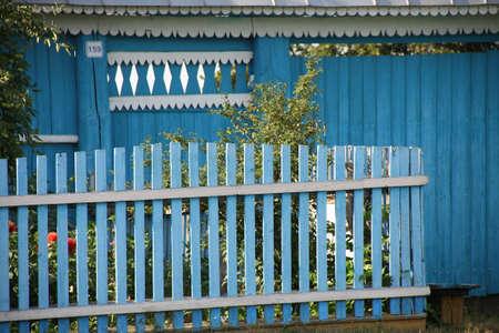 Blue yard fence.