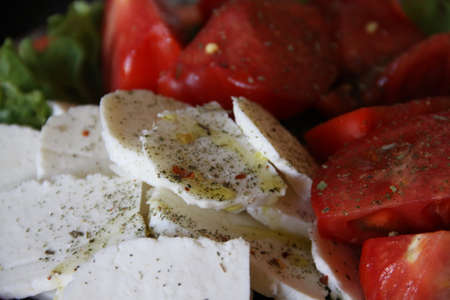 Italian salad with cheese and tomatos