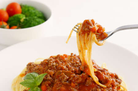 Spaghetti Bolognese and fresh salad                                 Stock Photo