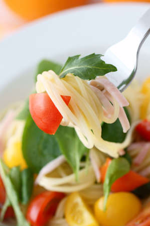 cold spaghetti with baby leaf photo