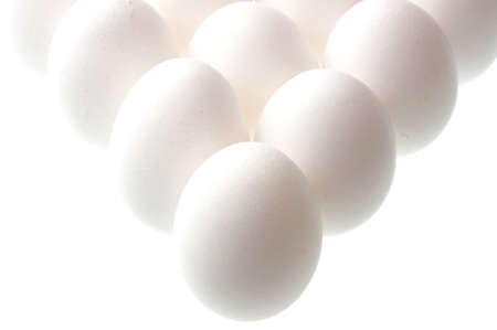 standing eggs on white background photo