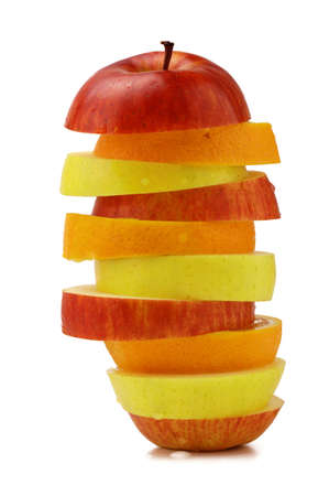 stacked up many sliced fruits on the white background photo